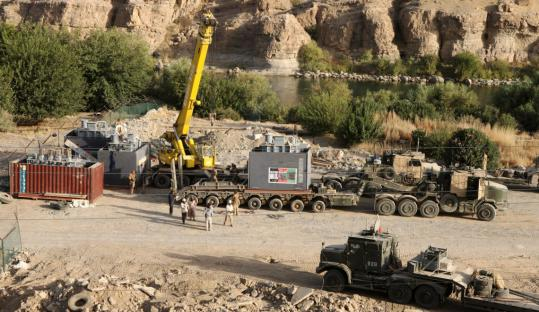 Equipment is offloaded from several of the 43 vehicles that arrived at Forward Operating Base Zeebrugge in Afghanistan Tuesday with equipment for the Kajaki hydroelectric dam.