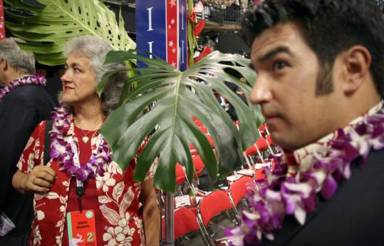 Hawaii delegates Marlene Hapai and Adam Deguire sported Hawaiian shirts and leis at the GOP convention in St. Paul.