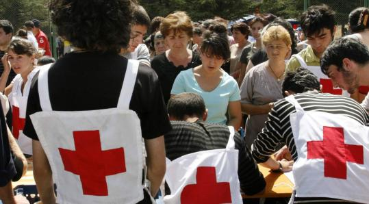 Refugees got a meal in a refugee camp in Gori, Georgia, yesterday. The United Nations refugee agency said Tuesday that 4,200 people had fled villages near South Ossetia to the nearby city of Gori because of harassment by marauding militias.