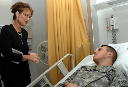 Alaska Governor Sarah Palin visited Army Private James Pattison during a morale tour at Landstuhl Regional Medical Center in Landstuhl, Germany, in 2007.