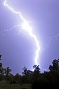 If lightning strikes your car, the metal body absorbs the current on its outside surface, keeping you safe inside.
