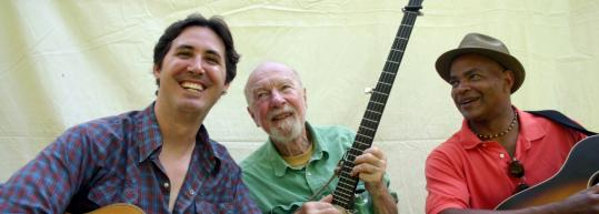 Tao Rodriquez-Seeger (left), Pete Seeger, and Guy Davis play two area farm-relief concerts.