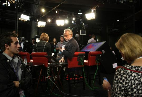 Wolf Blitzer (center) of CNN on the set at the Republican National Convention yesterday.