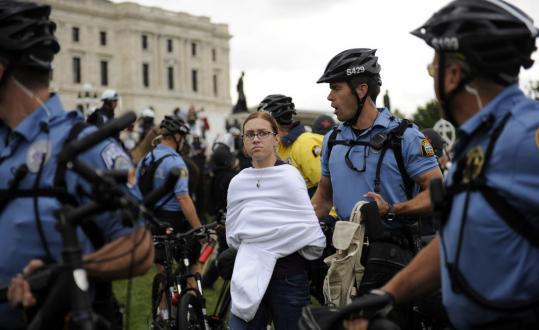 A protestor was taken into custody yesterday at the State Capitol in St. Paul, Minn., near the site of the Republican National Convention. Later, police blocked a march to the convention.