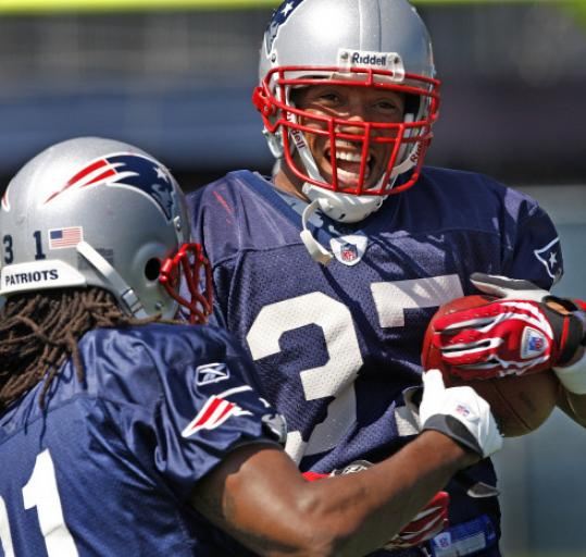 Safety Rodney Harrison (37) was on the ball with help from Brandon Meriweather during practice yesterday.