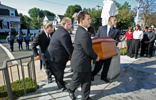Mark Wilson/Globe StaffThe casket of the 6-foot-7 former pro wrestler was carried into St. Joseph Church in Malden yesterday. He died Saturday at age 81.