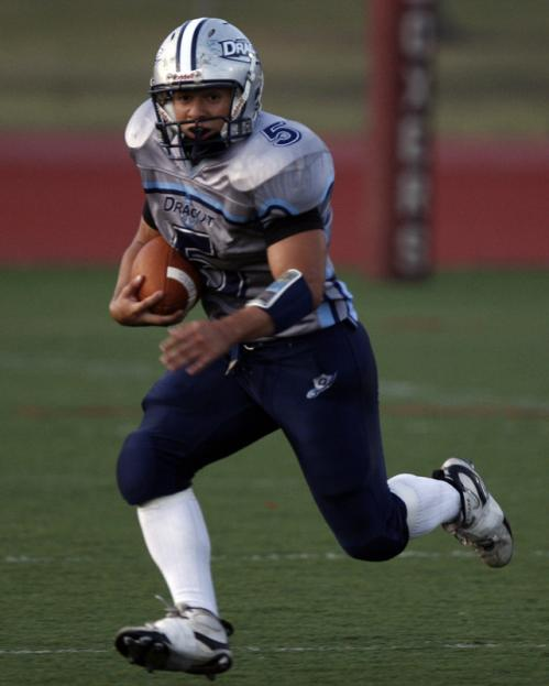 Dracut running back Jonathan Rivera (5) looks for running room.