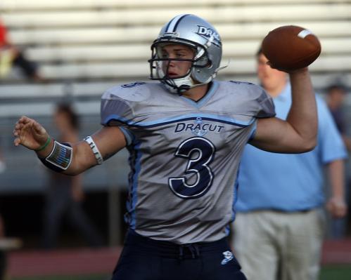 Dracut quarterback Matt Grimard (3) warms up before the season-opening game against Brockton.