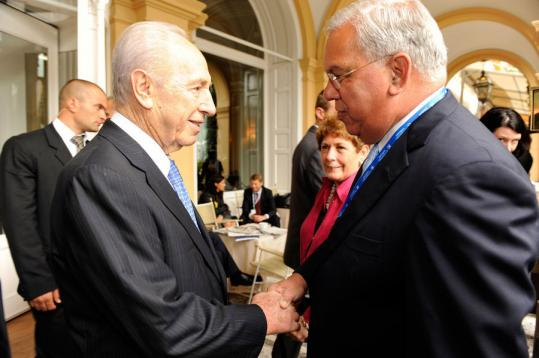 Mayor Thomas M. Menino exchanged greetings with President Shimon Peres of Israel during a break Friday at the conference in Cernobbio, Italy.