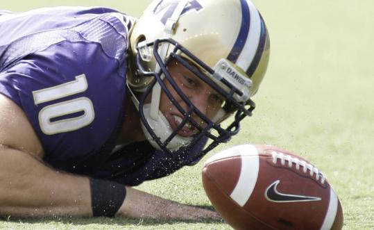 Although Washington recovered this Jake Locker fumble, the Huskies' didn't get all the breaks, and lost to BYU on a last-second blocked PAT.