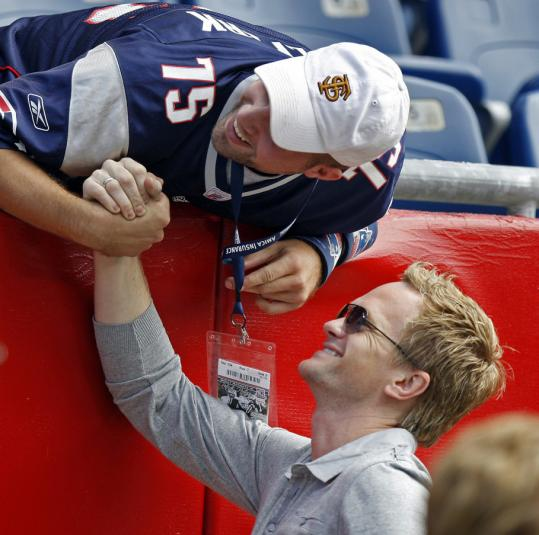 Neil Patrick Harris with a Patriots fan before the season opener yesterday.