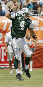 It's not a Lambeau Leap, just a joyous one as Brett Favre celebrates his first touchdown pass as a member of the Jets.