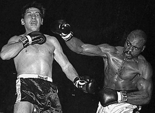 Joey Giardello, defending his middleweight crown, was jolted by Rubin ''Hurricane'' Carter in the ninth round of their title fight on Dec. 14, 1964, in Philadelphia.