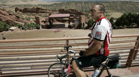 Vern Ciardella of Littleton, Colo., takes in the view after biking to the Red Rocks Amphitheater west of Denver last month.