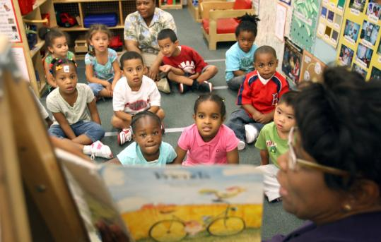 Teacher Josette Nicolas read the preschool class a story at the Castle Square School. New materials, including books, were bought with additional state funding for the school.