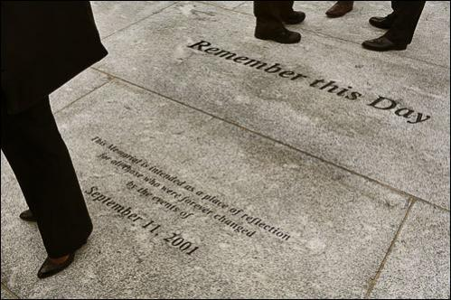 'Remember this Day' is etched in granite near the memorial.