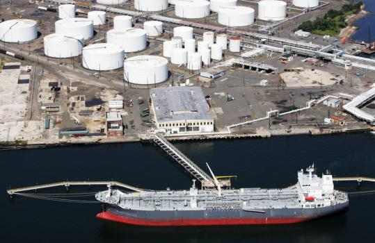 An oil tanker docked at a storage facility in Bayonne, N.J. Hurricane Ike's change in direction and OPEC leaders indicating the cartel won't cut production moved prices lower.