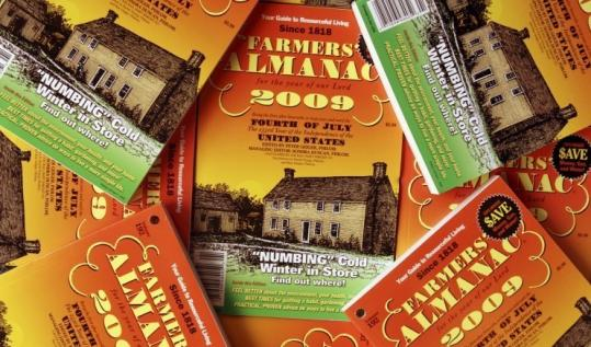 Copies of the Farmers' Almanac are displayed at the publisher in Lewiston, Maine. Almanacs around the country use traditional methods to create long-range weather charts