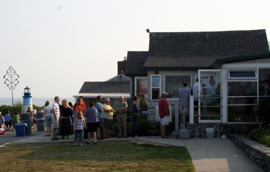 The Lobster Shack at Two Lights on Cape Elizabeth, Maine, is a beacon to patrons hungry for lobster rolls and the same view American master Winslow Homer might have had of Casco Bay.
