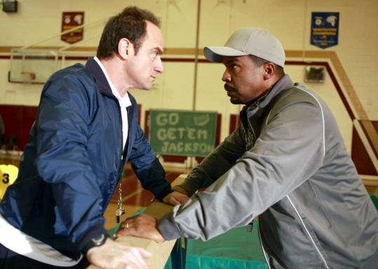 Christopher Meloni (left) and David Alan Grier face off as battling gym teachers.