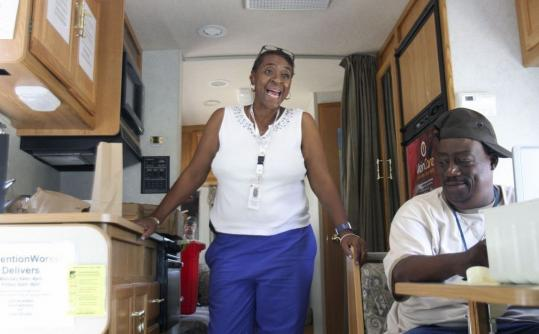 Hazel Smith and Reggie Jackson of PreventionWorks!, a needle exchange program that focuses on preventing the spread of HIV, aboard their Winnebago in Washington last month.