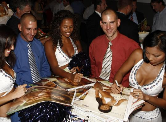 Alicia Barbaro (left), Asia Barnes (center), and Dinna Yap autograph calendars for Rob and Philip Fitzgerald.