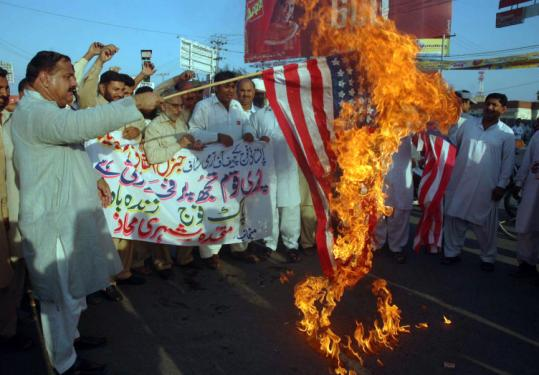 A Pakistani protester held a burning US flag during a protest yesterday in Multan against missile strikes in tribal areas.