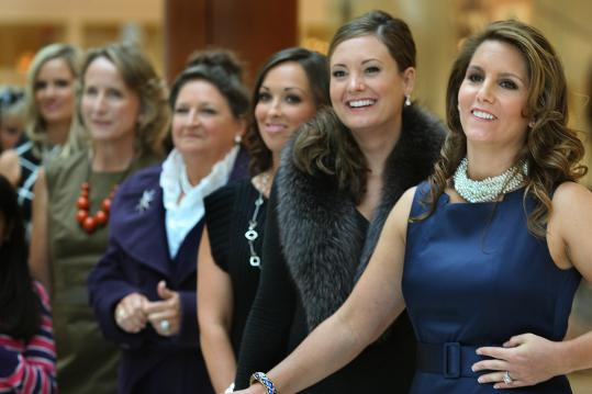 Whitney Hayes (center), Ashley Papelbon (second from right), and Tiffany Ortiz (right) at the Natick Collection yesterday.