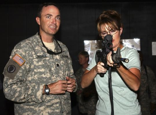 Private Christopher T. Grammer/Department of Defense via Associated Press/fileLieutenant Colonel David Cogdell helped Governor Sarah Palin of Alaska test out training equipment at Camp Buehring, Kuwait, on July 24, 2007.