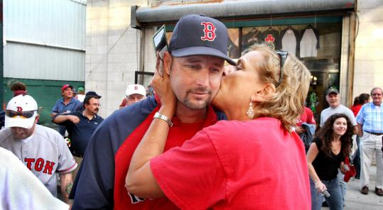 TIM WAKEFIELD, Red Sox pitcher, being kissed by a fan as he was handing out souvenir tickets commemorating the major league-record 456th consecutive sellout at Fenway Park, Sept. 8, 2008 - ''Oh, I don't know. I thought the whole thing was fun. I think they were just grateful that I was out there saying thanks. That's just a grateful fan. Her way of showing her appreciation - instead of shaking hands, she wanted to give me a kiss. OK. She [his wife, Stacey] wouldn't care. I told her about it anyway.''