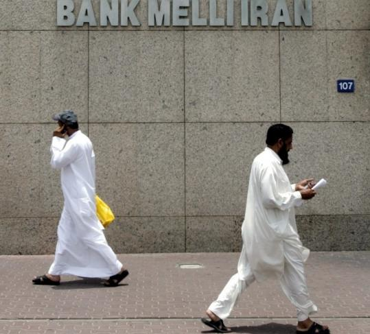 Two men passed by the main branch of Bank Melli Iran, the National Bank of Iran in Dubai, United Arab Emirates, in July.