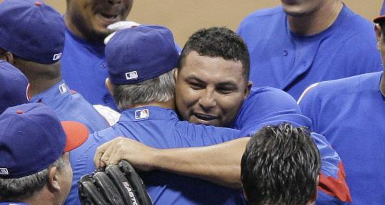 Carlos Zambrano celebrates with teammates after becoming the first Cubs pitcher in 36 years to throw a no-hitter.