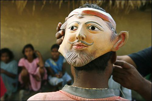 Honey collector Madhusudhan Mondal wears a mask on the back of his head in Bali, a village in the Sundarbans, India, Tuesday, Aug. 5, 2008. Locals believe that tigers do not attack humans from the front and wear masks on the back of their heads in the hope of warding them off.