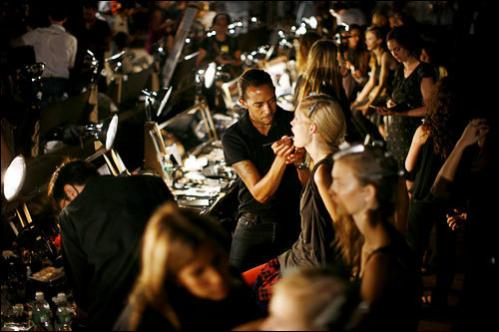 Models prepare backstage for the showing of the spring/summer 2009 collection of Proenza Schouler during Fashion Week in New York Monday Sept. 8, 2008.