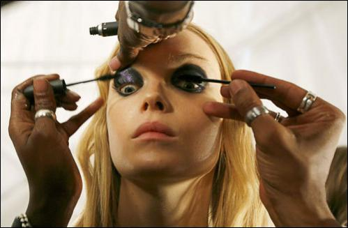 A model has makeup applied backstage before the start of the Miss Sixty Spring 2009 show during New York Fashion Week September 7, 2008.