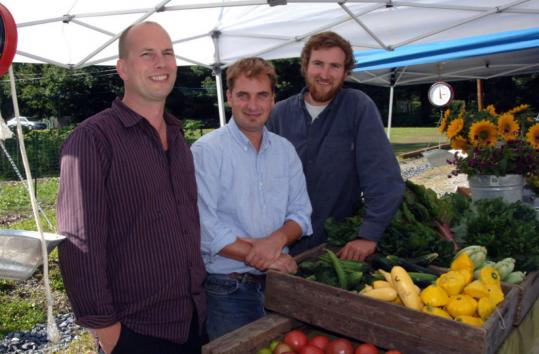From left: Peter, Jeremy, and Sean Stanton at a farmers' market in Great Barrington. Peter is a nutritionist, Jeremy is a chef, and Sean is a farmer.