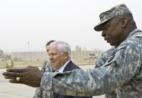 Secretary of Defense Robert Gates (left, with General Lloyd Austin) visited Baghdad yesterday and met with Iraqi leaders.