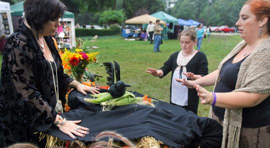 Mhorrigan, Shannon Regan, 11, and Michelle Kurker of the Moon Tribe perform a ritual during the Southeastern Massachusetts Pagan Pride Day festival.