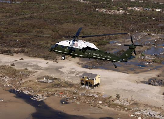 PABLO MARTINEZ/MONSIVAIS/ASSOCIATED PRESSPresident Bush viewed the damage from the air yesterday and urged Galveston evacuees to stay away until the city is deemed safe.