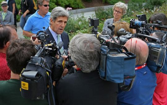 Senator John F. Kerry stopped to talk with a group of reporters before he voted yesterday in Boston.