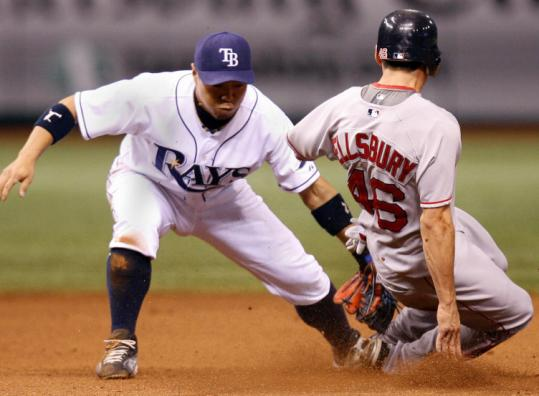 Rays second baseman Akinori Iwamura slaps the tag on Jacoby Ellsbury, who was attempting to steal in the eighth inning.
