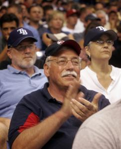 Red Sox fan Ted Haggis of New Bedford sat in front of Rays fans Jim Freeman and his wife, Carla Jimenez, last night.