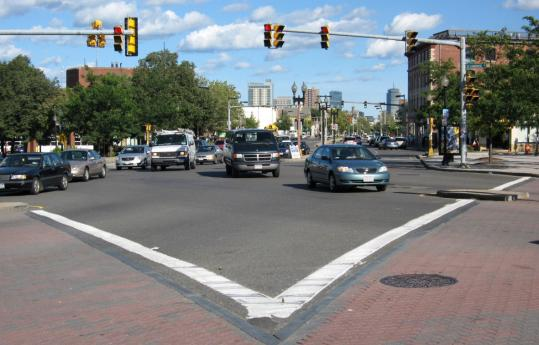 Drivers navigate the intersection of Brighton Avenue, Cambridge Street, and North Beacon Street.