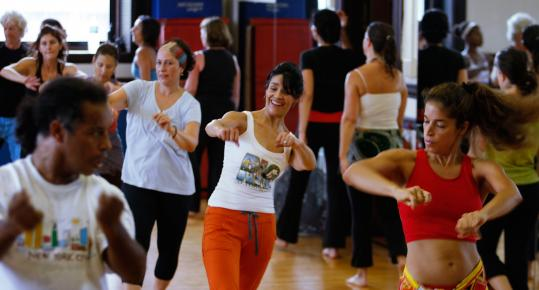 The scene at last Sunday's open house at the Dance Complex in Central Square included (above) students trying out the rhythms and moves of Afro-Brazilian dance in a workshop led by Mario Pereiera of New York City.