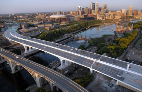 Drivers honked in celebration yesterday as the new Interstate 35W bridge over the Mississippi River opened in Minneapolis.