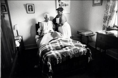 Domestic servant Winifred Boom, 54, adjusts a pillow for her employer in the Johanesburg suburb of Parkview in 1986.