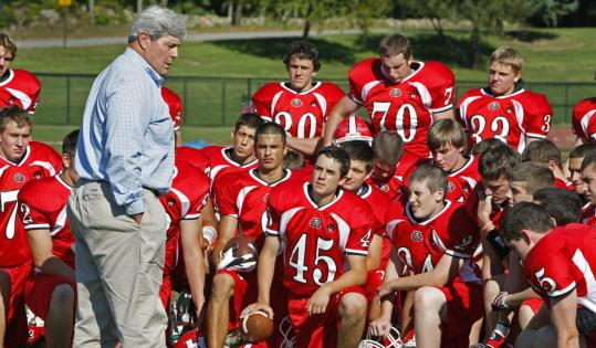 Patriots Hall of Famer John Hannah addressed the Holliston High football team at practice yesterday.