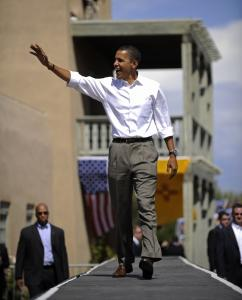 Senator Barack Obama waved upon arriving to address a rally in Espanola, N.M. yesterday, where he accused Republican John McCain of trying to run away from his fiscal record.