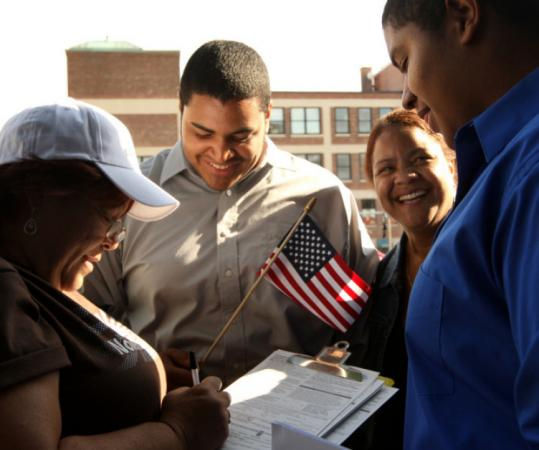 Mayra Fonseca beamed Wednesday as her sons, Luis Mota (center) and Carlos Mota registered to vote at Fenway Park.