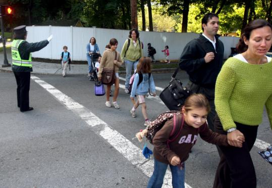 Parents and children crossed Chestnut Street in Newton on Wednesday as they headed to Rashi School.